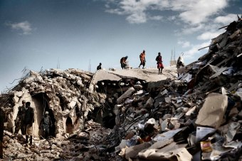 The 2010 earthquake in Haiti killed at least 100,000 people.